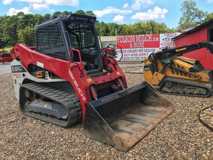 Takeuchi Skid Steer with Grapple Attachment